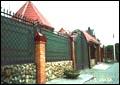 Въездные распашные ворота с калиткой и забором.
